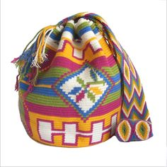 $90.00 Palomino Mochila Bag. About Wayuu Mochilas: These crochet Wayuu bags are made by Wayuu women and designed by Lombia & Co. The colors of the mochilas Wayuu are inspired by the vivid colors that surround region of La Guajira. Sand, sea, desert, sun and a clear sky are constants in the landscape. Geometric figures are a signature of these mochila bags.