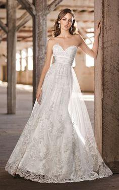I love the overlay on this one  Empire Waist Wedding Dress