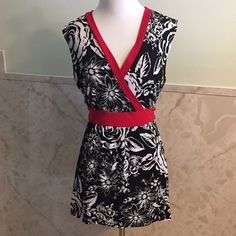 Floral Empire Waist Faux Wrap Top W/Waist Tie XL Classic black and white accented by red. The blouse has a floral motif and a wrap style without being an actual complicated wrap shirt. There's a tie around the waist that ties in the back. This is an XL. Saint Tropez Tops Blouses