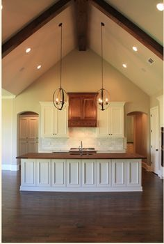 Track lighting installed to wash the vaulted ceiling with light and kitchen layout vaulted ceiling wood counter top island in kitchen parade of homes 2014 aloadofball Images