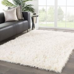 Hogan Faux Fur Rug, Ivory is part of Living Room Rug Fur - Add a cozy sense of style to your room with the Hogan rug The short ivory faux fur provides texture and softness to any aesthetic preference, from Scandinavian to shabbychic Fuzzy White Rug, White Faux Fur Rug, White Shag Rug, White Area Rug, Bedroom Carpet, Living Room Carpet, Rugs In Living Room, Fluffy Rug, Dream Rooms