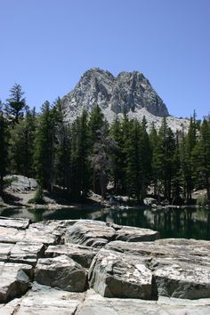 Crystal Crag and broken rocks face off at TJ Lake or Lake Barrett (not sure which), in Mammoth Lakes, California.    cc.eirewolfcreations.com