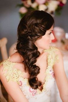 We're head over heels for this #vintage-inspired wedding hairstyle. This couldn't be a more perfect 'do for brides with lovely long hair. This curly, swideswept romantic style would work well in a historic venue. We recommend pairing it with a fitted lace gown and a pearl hair brooch to really give off a vintage vibe.  {Fiore Beauty}