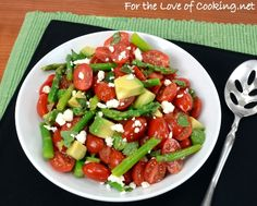 CHERRY TOMATO, ASPARAGUS, AND AVOCADO SALAD TOPPED WITH BASIL AND FETA