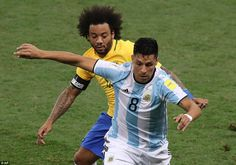Marcelo plays close attention to Argentina's Enzo Perez as they two teams played out a cagey opening quarter of an hour