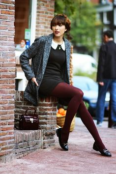 I love this style, which also resembles outfits I wear: I love the white color on the black dress, the adorable grey tweed jacket, the burgundy tights to brighten things up a little, & her hairstyle.