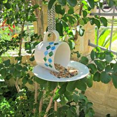another great idea ,made  mine and drilled a hole to secured and add  a bolt and nut , to cup and saucer, then glued. Add some old beads and jewelry as a hanging  rope. SEEDS OF LOVE  IN OUR GARDENS . MY BIRDS LOVES THIS SIMPLE  DESIGNS. LOVE THIS BIRD FEEDERS. CRAFTY LADY.