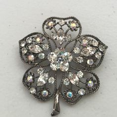 Vintage flower brooch Sparkly and beautiful vintage brooch! Lots of shiny rhinestones with a blue grey pearl in the center. Measures 3 x 3 inches. Vintage Jewelry Brooches