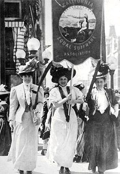 Leading a march of 300 women of the California Equal Suffrage Association in Oakland August 27 1908 were (l to r) Lilllian Harris Coffin, Mrs. Theodore Pinther, Jr. and Mrs. Theodore Pinther, Sr.