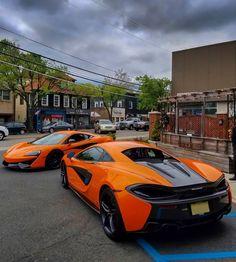 2 McLaren 570S' painted in McLaren Orange  Photo taken by: @drivingforceclub on Instagram