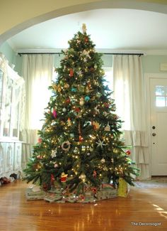 Christmas Tree beautifully shaped - expertly decorated. Perfect!