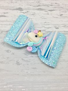 The bows are stunning with the chunky glitter bow offset against the iridescent fabric topped with an adorable unicorn embellishment. The bows measure approx 4 inches and would delight any child that loves these magical creatures. The hair bow is listed as being mounted on a clip, however if you would prefer the bow to be attached to a nylon hair band please send me a message or add to the comments at point of sale. I have lots of colours in stock so if you dont see the colour combination…