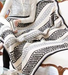 Get a modern look with this classic black and white Domino Crochet Bobble Stitch Throw. This easy crochet pattern is a great way to add a fresh, chic vibe to a dreary room.