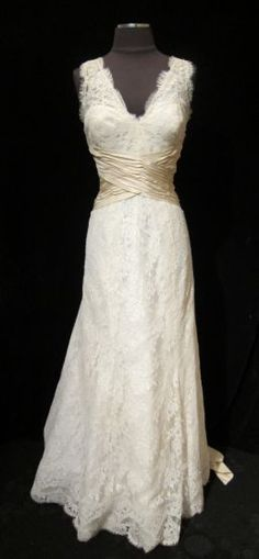 a lovely french lace gown from Christos. and a welcome return to non-strapless styles. gorgeous for an outdoor wedding. Le Dress boutique Atlanta Ga. $1195.