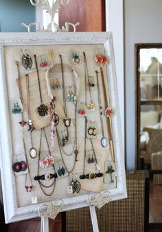 ah-hah!!!!  an easel, I was trying to figure out how to do something like this without having walls to hand stuff on.  Duh!!! Jewelry display