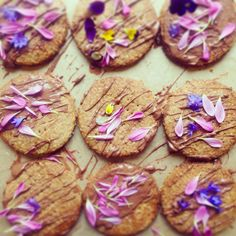 homemade digestives with chocolate drizzle and edible flowers
