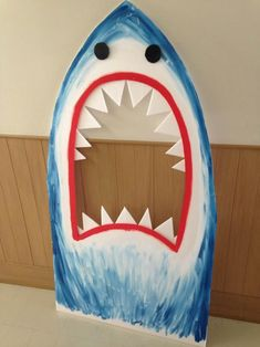 FUN photo booth prop shark. Made with foam board, acrylic paint, super glue, and kids' tempura paint.  Kids got a huge kick out of it for the little's ocean themed birthday party.