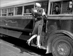 An unknown couple shares a kiss goodbye. (c. 1940s)