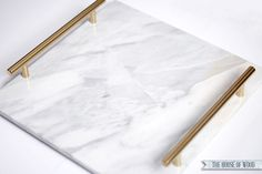 How to Make an Elegant $188 Marble Tray for $18 - great for a nightstand, bathroom counter or coffee table! Need marble tile, chrome drawer pulls, Rustoleum gold spray paint, self-adhesive vinyl bumper stickers (for feet on the underside), and 6000 Industrial Strength Adhesive