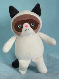A stuffed Grumpy Cat! What could be better? And, when I say 'better', I mean, 'miserable, hateful and critical yet somehow both charming and lovable'.