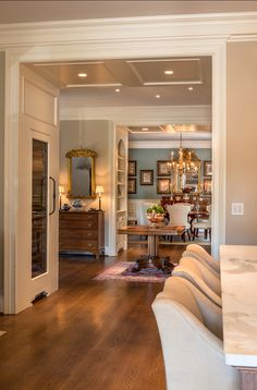 Traditional Home with Timeless InteriorsA view of the dining room (similar paint color: Benjamin Moore Buxton Blue HC-149) towards the kitchen. Hardwood floors are white oak, quarter sawn in planks 11 inches wide.