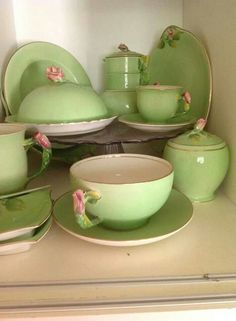 Green and white with a touch of pink dinnerware.