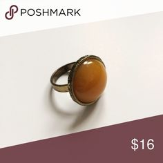 "Bronze Round Ring with Yellow Stone This gorgeous ring features a bronze colored, decorative setting with a yellow stone. Fits a size 8. This is costume/fashions jewelry therefore the stone and setting are not ""real"" Jewelry Rings"