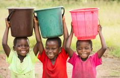 """Sheleshita, Maureen and Sikola, all 7 years old, met at the new UNICEF-supportedwater point in their village in Malawi.The young girls no longer have to walk 5km each day to fetch water, leaving more time for study and play. When asked what water means to them, they simply smile. """"Water is happiness"""", Sikola says. © UNICEF Malawi/2015/Chikondi"""
