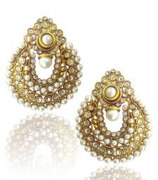 Beautiful pearl polki earring with pearls and polki studded on it. White pearls and stones and its amazing design make this jewellery very attractive.  Care Instructions: Keep it dust-free & dirt free in a plastic pouch. Remember to apply your hairspray, perfume, and cosmetics before putting your jewellery on.  Carefully hand-picked for a stylish you. From the house of ADIVA.