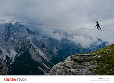 "Monte Piana, Dolomites/Italy - September 08, 2013: An Acrobat On A Rope Tended Above An Abyss During ""Highline Meeting"" Of Tightrope Walkers From Around The World Taking Place Every Year On September Stock Photo 321781736 : Shutterstock"
