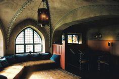 Vaulted ceilings, cathedral glow, window-seat luxe. Eliel Saarinen's Villa Hvitträsk, #Finland.