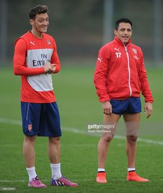 Mesut Ozil and Alexis Sanchez of Arsenal during a training session at London Colney on April 10...