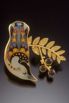 "Artist: Michael Romanik  Title: Whitebreasted Nuthatch Brooch  Materials:Cloisonne enamel on fine silver, 18K, 22K, 24K, sterling, iolite  Dimensions: 2""h x 2""w x 3/8""d    Artist Statement: This piece won the NICHE Award in the category of ""Metal - Enamel"" at the 2007 Buyers Market of American Craft wholesale show in Philadelphia PA"