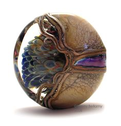 This is one beautiful lampwork bead!  Peacocks in Chaos by Sherry Bellamy