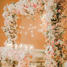 A lush floral arch is sure to stun your reception attendees! See more of this blush-hued wedding on WedLuxe.com. (photo: @agistudio, planning and design assistance: @florafleurweddings, floral and decor: @coverscouture, venue: @fairmontroyalyork)