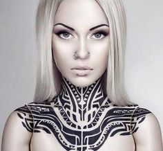 egyptian or tribal tattoo on neck, blonde cleopatra. Her name is Teya Salat
