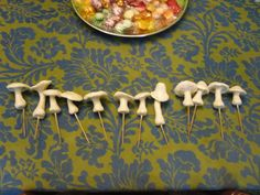 glow-in-the-dark polymer clay mushrooms on skewers to stick into the ground! (or wherever else.) Made by Craftsterer sugarsandwitch