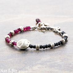 Black spinel and rhodolite garnet ladybug bracelet with Hill Tribe silver beads and a Bali silver clasp by NanandBiz