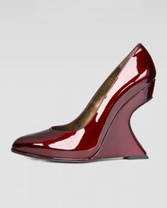 STUART WEITZMAN eye-catching glossy patent leather wedge pump with crystal-cutout.
