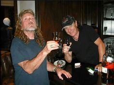 Robert Plant with AC/DC's vocalist Brian Johnson.