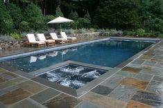 Slate makes a great contemporary pool deck, and can be installed on a base of compacted stone dust...