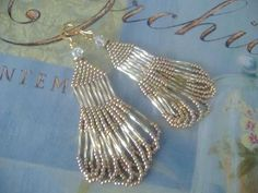 Alot of bling with the lightness of seed beads. Great earrings for bold looks or under dark hair. ~Auretha
