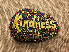 Kindness rocks project. Throw Kindness Around Like Confetti Painted rock. Artistro paint pens work awesome for this!
