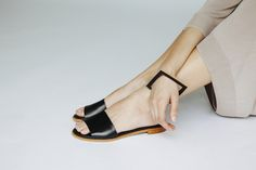Creating complements with harmonic lines and shapes. In this pic, the model is wearing the Metrica squared bracelet made with authentic eco friendly leather, developed and handmade in Spain. The sandals are 100% designed and produced in Spain with genuine leather, following the laws of geometry and natural harmony. A new way to make jewelry.