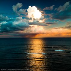 Intense ray of sunlight hitting a high level cloud ~ creating a huge flare in the ocean over Diamond Head lookout in Hawaii.  by Cameron Brooks