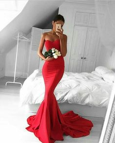 Long red gown with a sweet heart neckline.