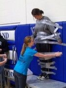 """Principal at Ashland-Greenwood High School  was duct taped to the wall during the Pep Rally as part of the National Honor Society's fundraiser for the Leukemia and Lymphoma Society.  For the """"STICK IT TO CANCER"""" activity, NHS members sold duct tape tickets to students during lunch.  During the Pep Rally, each student who had purchased a ticket received a piece of duct tape with which to apply to the principal in order to tape her to the wall."""