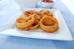Baked Onion Rings (Gluten Free). I ground up white grits for the cornmeal, I used 1/2 coconut flour and 1/2 multipurpose red mill gluten free flour since I didn't have rice flour. Use more oil for spraying on top next time? Used arrowroot instead of cornstarch. Not too bad :)