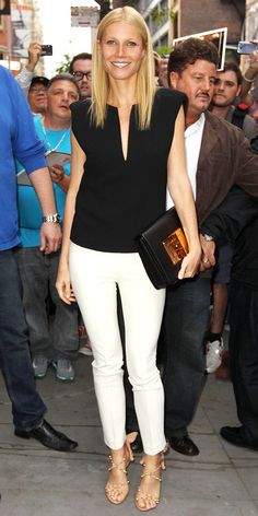 Paltrow sat on a panel at the Soho Apple store in a plunging Barbara Bui top, white trousers and edgy sandals.