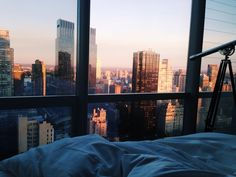 bedroom with city view, via ozei: sunrise in manhattan
